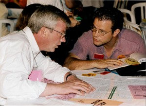 Peter Kormos, left, talks with CUPE Local 79 President Tim Maguire at the 1996 ONDP Convention.